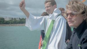 10 août 2014 : Luc PIALOU, curée de Dinard, lors du pardon de la mer et des bénédictions des bateaux à DInard (35), France.  August 10th, 2014: Breton Pardon in DInard, France.